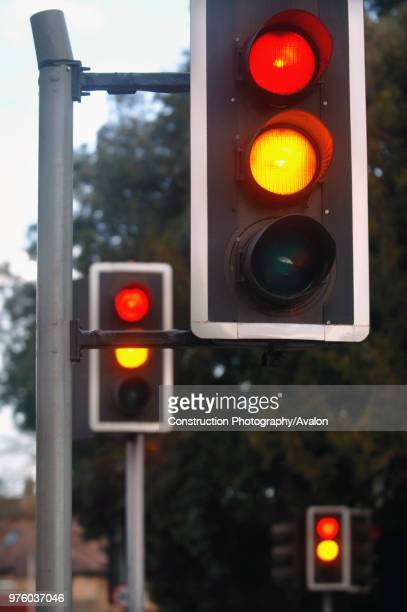 traffic lights showing amber and red at a crossroads UK
