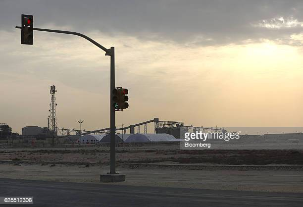 Traffic lights stand on the highway with the aluminium processing plant at the Ras Al Khair Industrial City operated by the Saudi Arabian Mining Co...