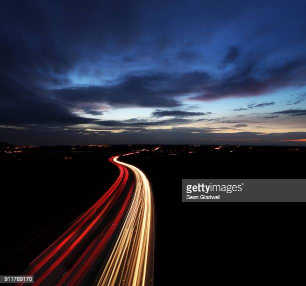 traffic long exposure - headlight stock pictures, royalty-free photos & images
