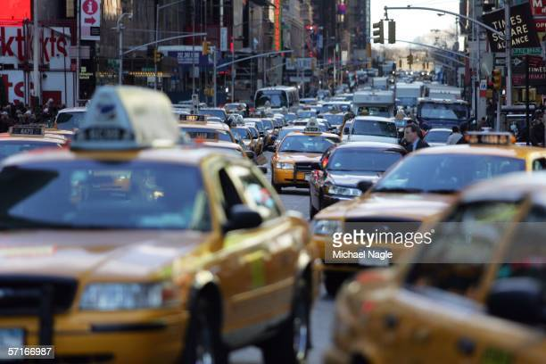 Traffic makes its way through Times Square on March 23 2006 in New York City According to the Environmental Protection Agency New York and Los...