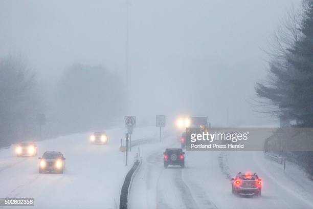 Traffic moved slowly along the Turnpike Spur in Falmouth Tuesday morning December 29 as the first snowstorm of the season hit Maine