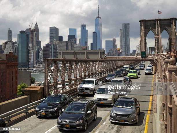 Traffic moves across the Brooklyn Bridge August 2 2018 in New York City On Thursday the Trump administration announced a proposal to weaken...