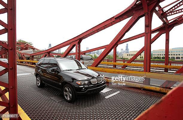 Traffic moves across the North Avenue doubleleaf trunnion bascule bridge over the Chicago River built in 1907 June 20 2006 in Chicago Illinois This...