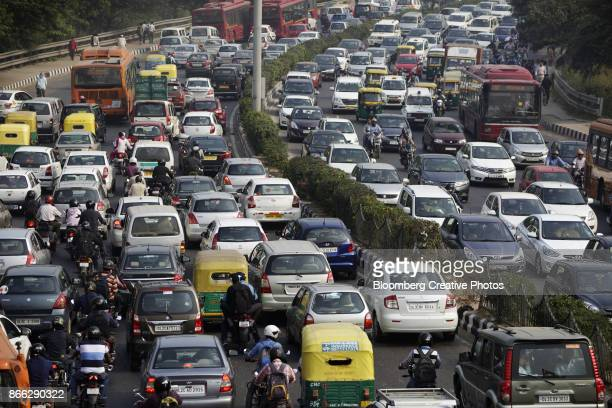 Traffic moves along a highway during morning rush hour in India