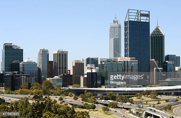 Traffic moves along a highway in front of buildings in the central business district in Perth Australia on Thursday March 6 2014 The Western...