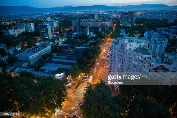 Traffic moves along a road as residential and commercial buildings stand in Dushanbe Tajikistan on Saturday April 21 2018 Flung into independence...