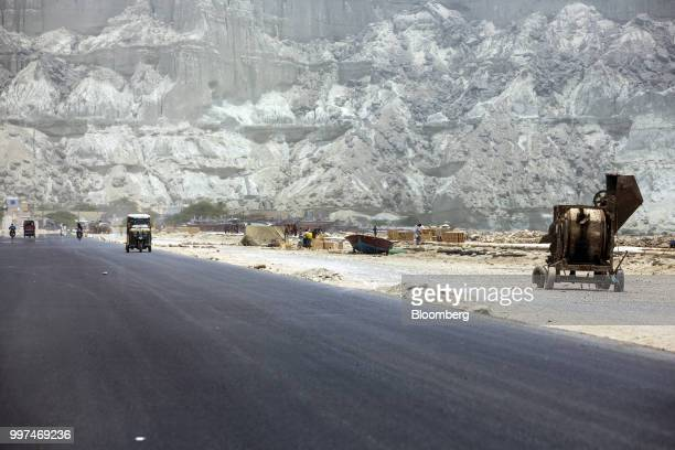 Traffic moves along a road next to a development site on Marine Drive in Gwadar Balochistan Pakistan on Tuesday July 4 2018 What used to be a small...