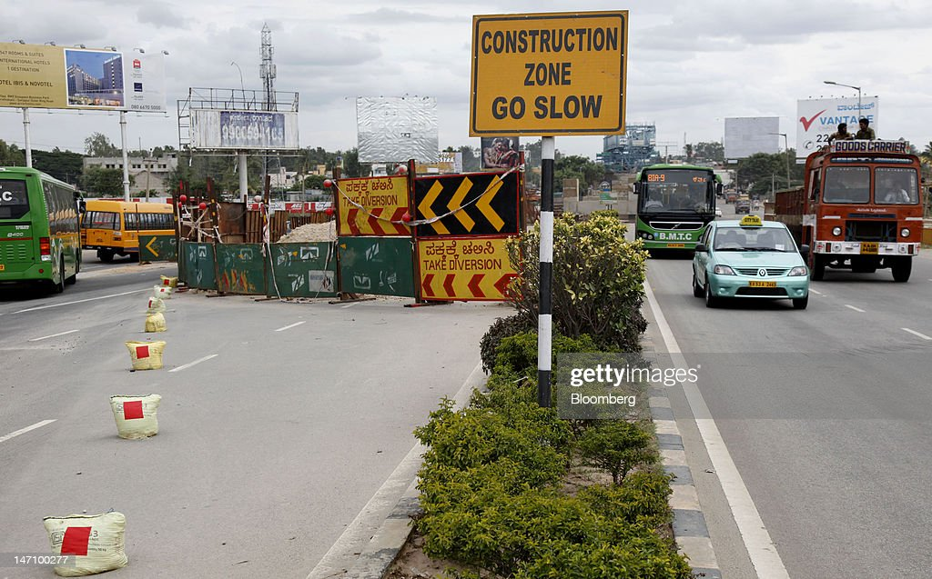 Traffic moves along National Highway 7 as road construction takes