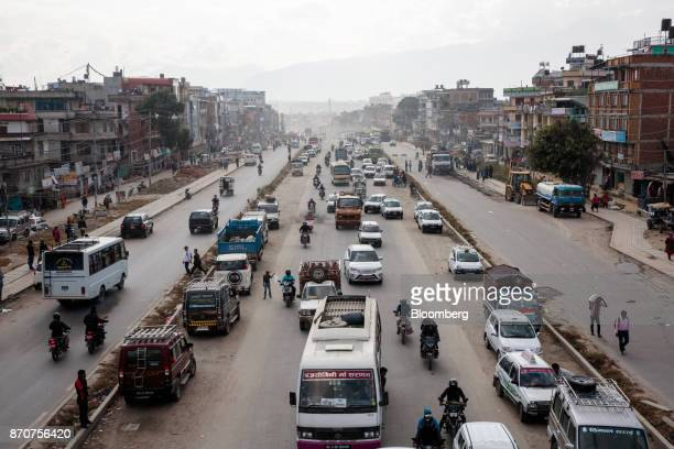 Traffic moves along road in Kathmandu Nepal on Wednesday Nov 1 2017 India and China have often jostled for influence in Nepal a nation of 28 million...