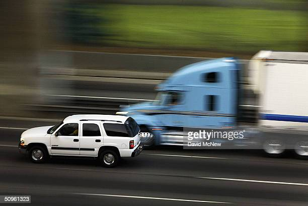 Traffic moves along the 101 freeway near Hollywood on June 14 2004 in Los Angeles California New California auto emissions regulations proposed today...