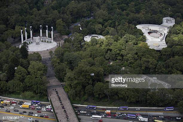 Traffic moves along the Bicentennial Inner Loop as the Altar of the Homeland left stands in the first section of Chapultepec Park in Mexico City...