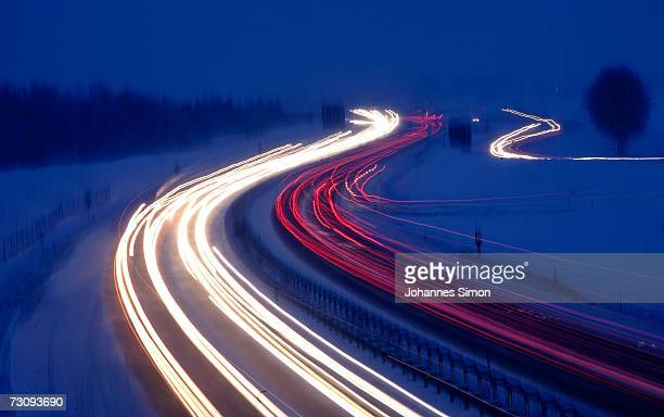 Traffic moves along the snowcovered motorway A96 near Etterschlag west of Munich on January 24 2007 in Bavaria Southern Germany After warmer...