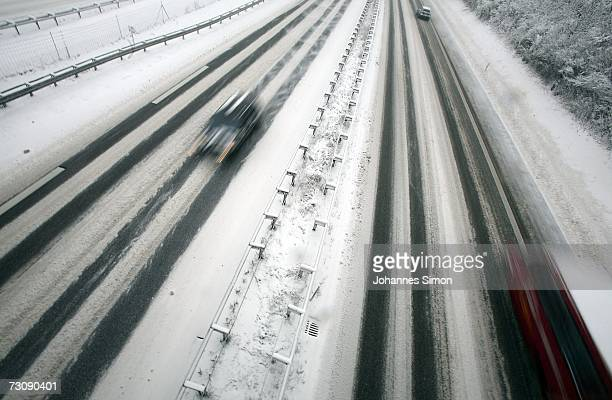 Traffic moves along the snowcovered motorway A96 near Schoffelding west of Munich on January 24 2007 in Bavaria Southern Germany After warmer...