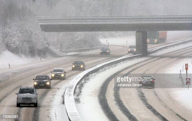 Traffic moves carefully along the snowcovered motorway A96 near Schoffelding west of Munich on January 24 2007 in Bavaria Southern Germany After...