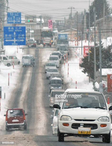 Traffic moves during a snow storm in Towada City Aomori Prefecture north of Honshu Japan on Friday Dec 26 2008 Japan Airlines Corp and All Nippon...