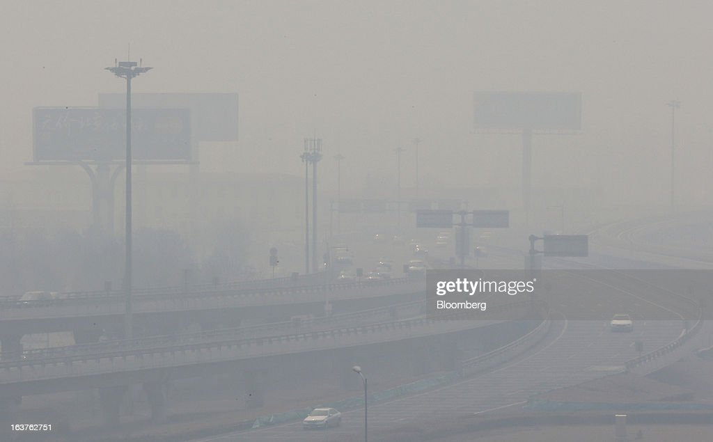 Traffic moves on elevated highways in haze in Beijing, China, on Friday, March 15, 2013. China maintained its economic-growth target at 7.5 percent for 2013 while setting a lower inflation goal of 3.5 percent, setting up a challenge for new leaders to keep prices in check without harming expansion. Photographer: Tomohiro Ohsumi/Bloomberg via Getty Images