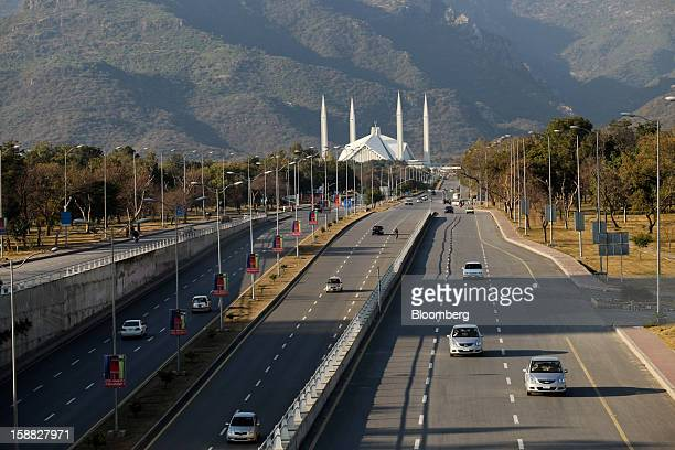 Traffic moves on Faisal Avenue in front of Faisal Mosque in Islamabad Pakistan on Sunday Dec 30 2012 Pakistan's economy will probably expand 35...
