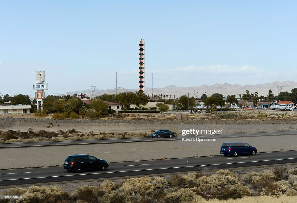 Traffic moves on US Route 15 as it passes the world's tallest thermometer on January 10, 2013 in Baker, California. Erected in 1991 by a local businessman and measuring 134-feet in height to commemorate the United States' record temperature of 134 degrees Fahrenheit, the thermometer has been billed as the world's tallest. The current owner has now placed the landmark up for sale due to the burden of its running costs, setting an asking price of $1.75 million.