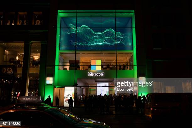 Traffic moves outside the Microsoft Corp flagship store during the Xbox One X game console global launch event in New York US on Monday Nov 6 2017 As...