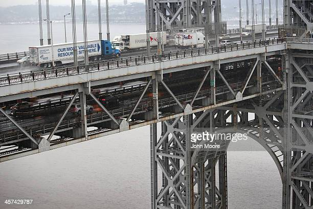 Traffic moves over the Hudson River and across the doubledecked George Washington Bridge on December 17 2013 in Ft Lee New Jersey New Jersey's...