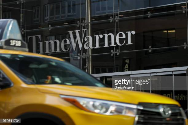 Traffic moves past the Time Warner Center June 12 2018 in New York City A federal judge today said that ATT can move forward with its $85 billion...