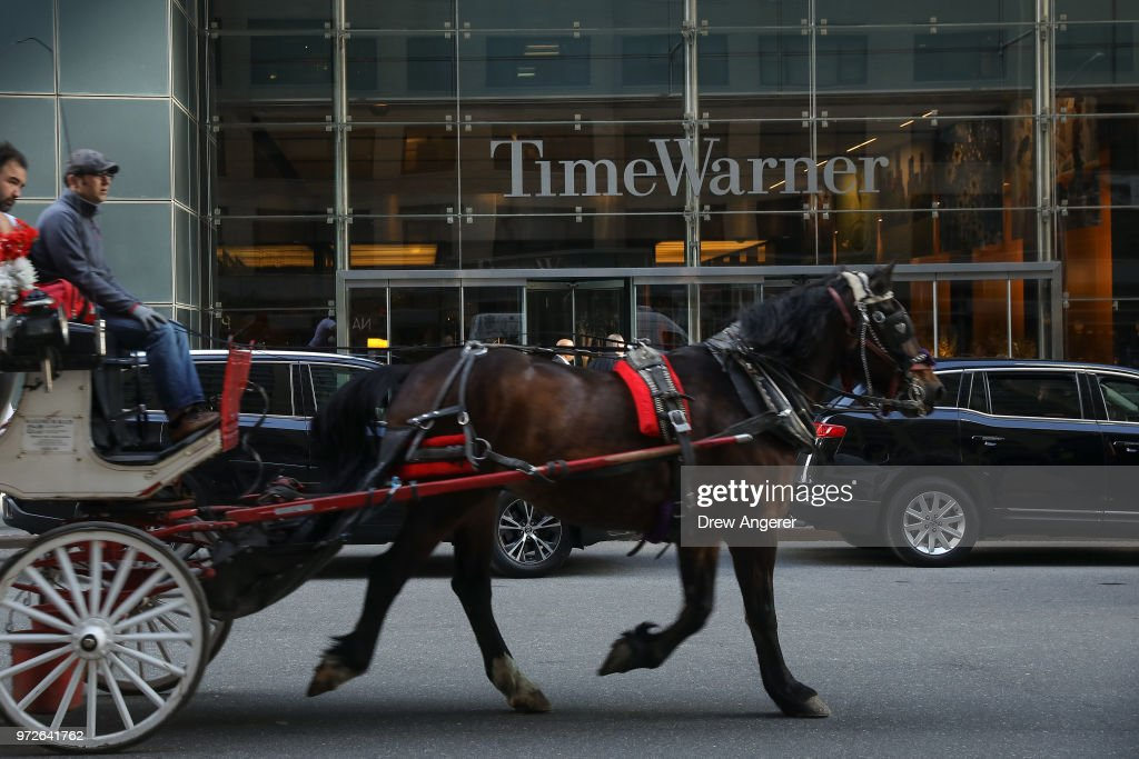 Traffic moves past the Time Warner Center, June 12, 2018 in New York City. A federal judge today said that AT&T can move forward with its $85 billion acquisition of Time Warner, which the U.S. Justice Department had sought to block.