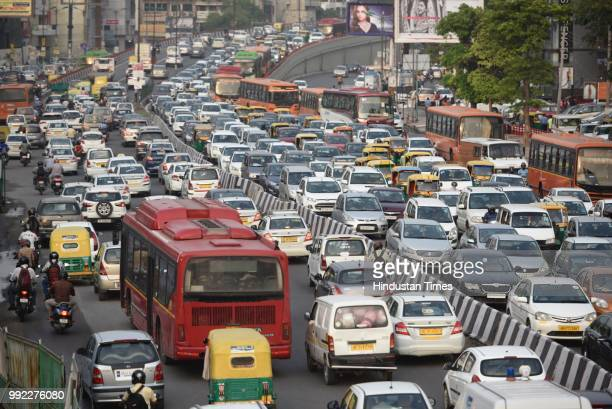 Traffic moves slow after heavy monsoon rains lashed the city at South Extension on July 5 2018 in New Delhi India