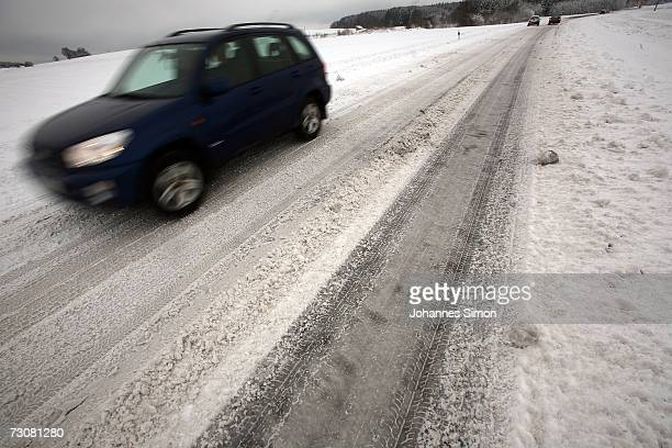 Traffic moves slowly along a snowcovered road near Schwifting on January 23 2007 in Bavaria Southern Germany After warmer temperatures than usual in...