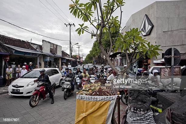 Traffic moves through an active Legian street three days ahead of 'Silence Day' on March 9 2013 in Denpasar Bali Indonesia Nyepi means 'Day of...