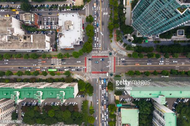 Traffic moves through an intersection as residential buildings stand in the Yeouido financial district in an aerial photograph taken above Seoul...