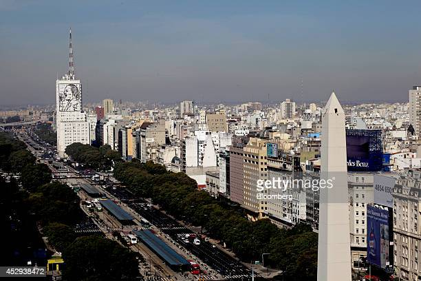 Traffic moves through downtown Buenos Aires Argentina on Wednesday July 30 2014 A top Argentine banker and former Economy Ministry official arrived...