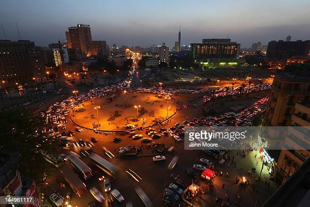 Traffic moves through Tahrir Square after sunset on May 21 2012 in Cairo Egypt Fifteen months after hundreds of thousands of Egyptians filled the...
