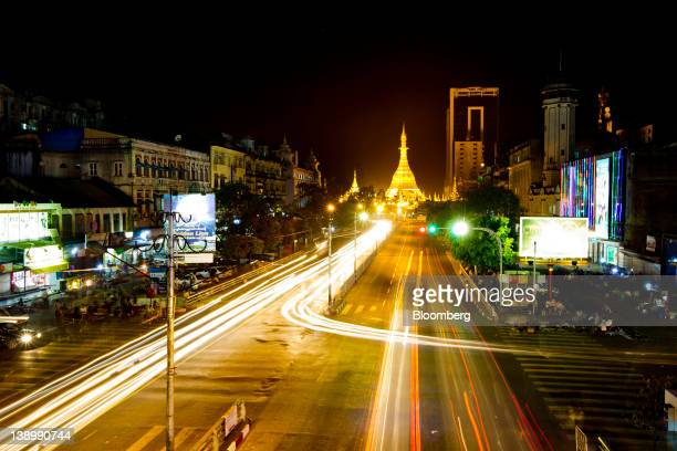 Traffic moves through the streets of Yangon Myanmar on Wednesday Dec 21 2011 The European Union offered a 150 million euro assistance package to...
