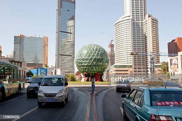 Traffic moves through Youhao Square in Dalian Liaoning Province China on Saturday Sept 17 2011 Dalian a major shipping port is the second largest...