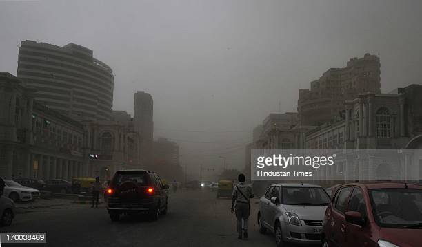 Traffic moving at Connaught Place during a dust storm on June 6 2013 in New Delhi India Rain and strong winds lashed the capital Thursday evening...