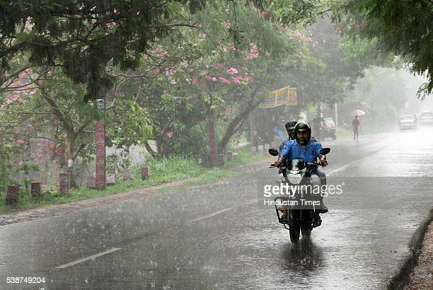 Traffic moving in heavy showers as the first winds of southwest monsoon hits Kerala on June 7 2016 in Thiruvananthapuram India The news arrival of...