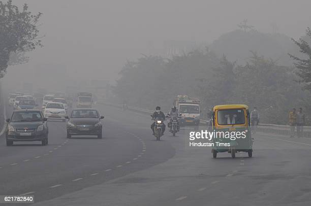 Traffic moving in smog in morning on November 8 2016 in Gurgaon India After a week of smog filled air the city on Tuesday finally wakes up to a clear...