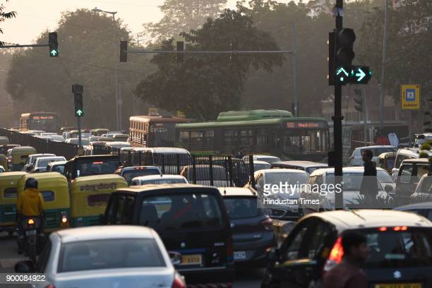 Traffic moving slow near Connaught Place on December 31 2017 in New Delhi India People of Delhi throng to the markets and parks ahead of new year