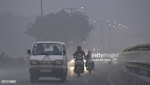 Traffic moving slowly due to thick smog at Ring Road in evening as the whole city is engulfed in heavy smog air quality deteriorated sharply...