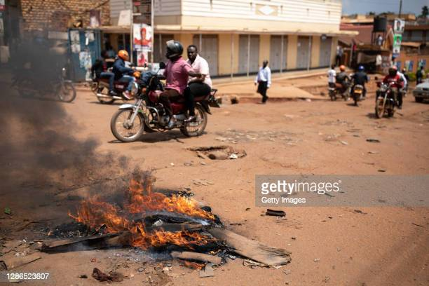 Traffic navigates past a protester roadblock on November 19, 2020 in Kampala, Uganda. Rioting began on Wednesday after presidential candidate Bobi...