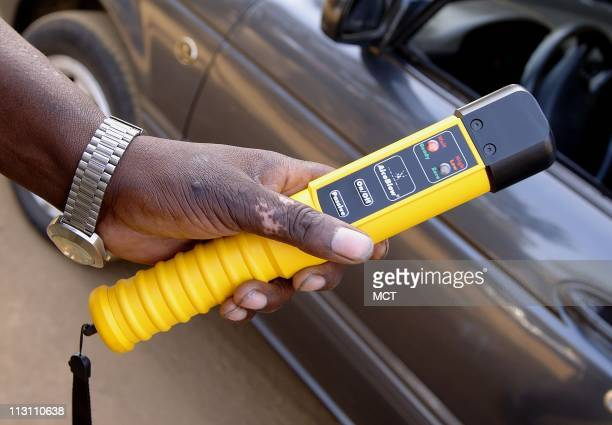 Traffic officer Muli shows a breathalyzer used at a traffic checkpoint Use of the device is rare in African countries but authorities want to curb...