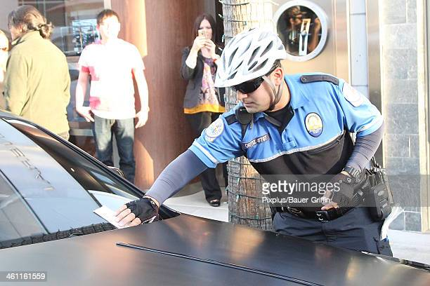 A traffic officer places a ticket on the car of Kim Kardashian on January 06 2014 in Los Angeles California