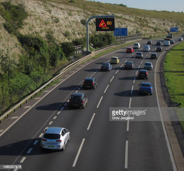 traffic on a curve on a busy expressway - autonomous technology stock pictures, royalty-free photos & images