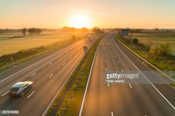 Traffic on a motorway at sunrise, UK