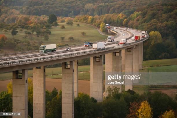 traffic on autobahn bridge (dawn) - column stock pictures, royalty-free photos & images