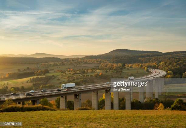 traffic on autobahn bridge (dawn) - north rhine westphalia stock pictures, royalty-free photos & images