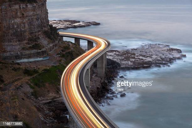 traffic on bridge - wollongong stock pictures, royalty-free photos & images