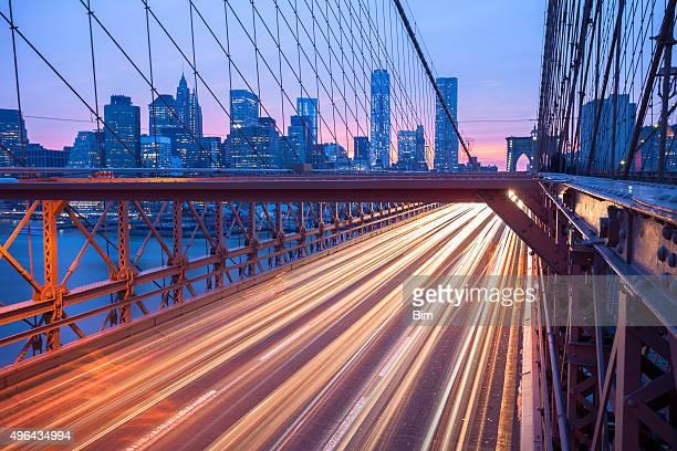 Traffic on Brooklyn Bridge at Dusk, Manhattan Skyline, New York