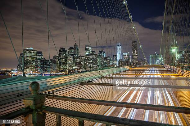 traffic on brooklyn bridge at night, new york, usa - christine wehrmeier stock pictures, royalty-free photos & images