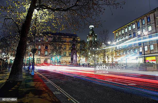 traffic on charing cross road at night - anatoleya stock pictures, royalty-free photos & images